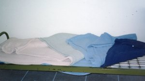 My metal cot and blanket mattress.