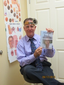 Dr. Spitzer holding is signed copy of Allergic to Life.