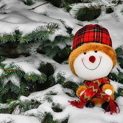 stuffed snowman in the snow